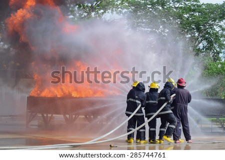 outdoor fire fighter training use two water line for extinguish a fire and protect team
