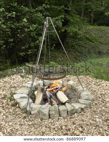 outdoor fireplace with barbecue equipment