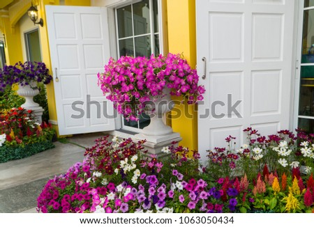 outdoor flowers arrangement in style of a mini garden decoration and a big vase of pink