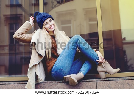 Outdoor full body portrait of young beautiful happy smiling girl posing on street. Model looking at camera. Lady wearing stylish winter clothes. Female fashion. Toned #522307024