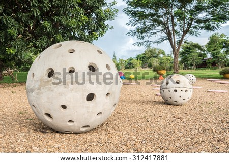 outdoor furniture in garden  concrete bench in sphere shape and colorful hanging lamp under tree