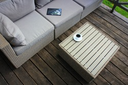 Outdoor furniture lounge group with chairs, sofa and table in a patio. Seating on the balcony, is a recreation place.