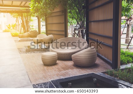 outdoor furniture rattan armchairs and table on terrace #650143393