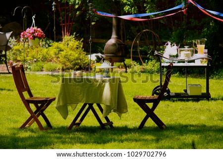 Outdoor garden party - Shutterstock ID 1029702796