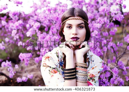 Outdoor high fashion portrait of young woman model, posing with trendy accessories and boho chic clothes. Fashion blogger outfit close up. Street style concept photo toned style instagram filters #406321873