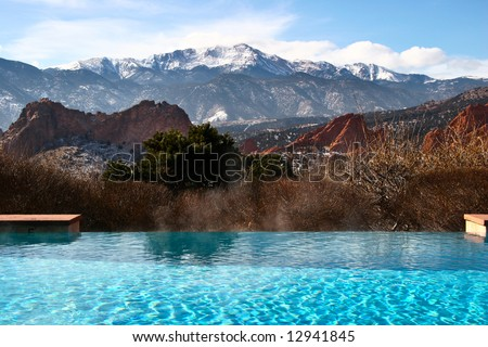 Outdoor infinity pool with a view of Pike's Peak and Garden of the Gods Park in Colorado Springs Colorado USA.
