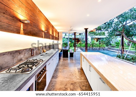 outdoor kitchen with a stove an ...