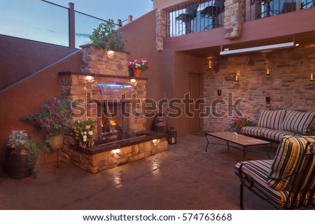 Outdoor Living Space with Awesome Fire Place with a Water feature in front