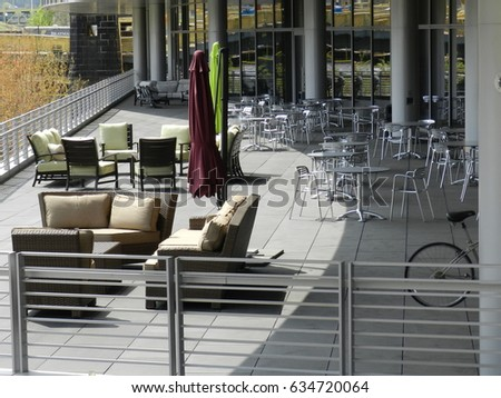 Outdoor Lunch Room With Aluminum Chairs And Outdoor Furniture