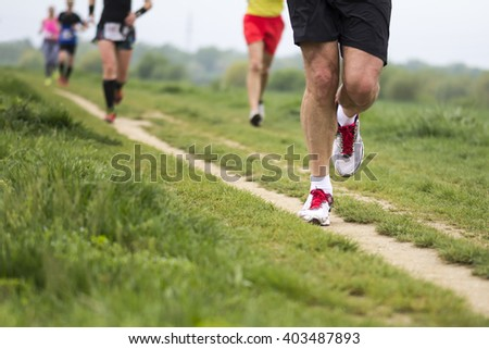 Outdoor marathon cross-country running fitness and healthy lifestyle #403487893