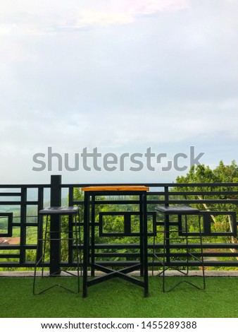 Outdoor, Nobody on chair and table with sky background