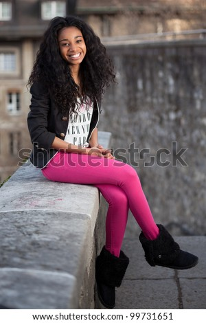 Outdoor of a  portrait beautiful young african american teenage girl
