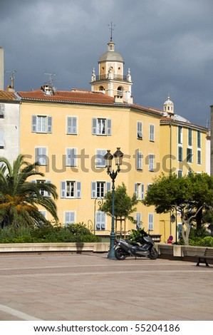 outdoor park Diamant Square with palm trees and view of old city architecture Ajaccio Corsica France