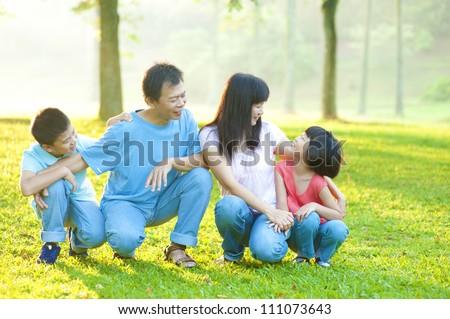 Outdoor park happy Asian family