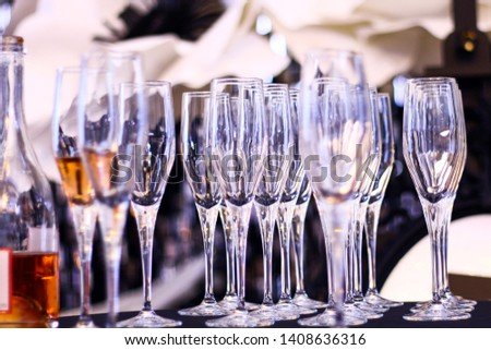 Outdoor party table with drinks and waiter with apron on background. #1408636316