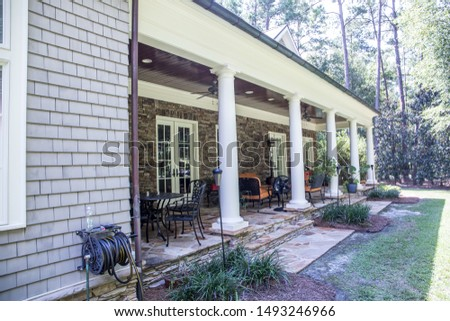 outdoor patio porch of traditional upgraded custom home with seating for entertaining and dining #1493246966