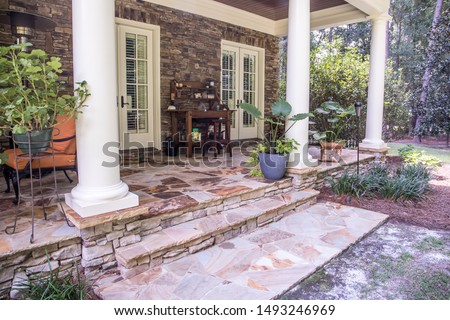 outdoor patio porch of traditional upgraded custom home with seating for entertaining and dining #1493246969