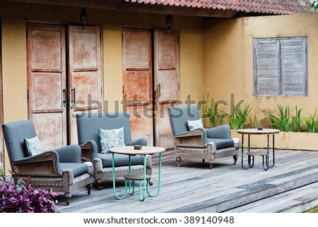 Outdoor patio seating with nice bench chairs at sunset #389140948
