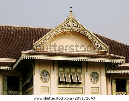 Outdoor perspective view with architecture details of an old vintage colonial style house: KHUM CHAO LUANG, in MUENG PHRAE district in THAILAND.