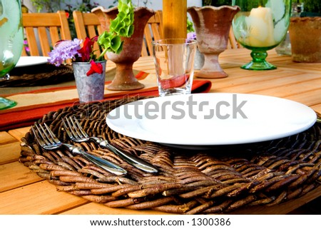 Outdoor place setting ready for summer BBQ