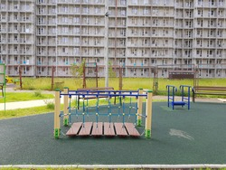 Outdoor Playground without children. New development of multi-storey buildings