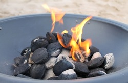 Outdoor portable fire pit with burning coal