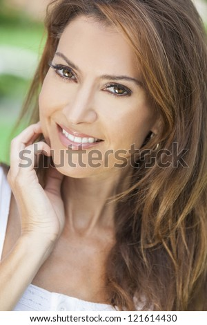 Outdoor portrait of a beautiful middle aged brunette woman in her forties