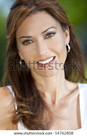 Outdoor portrait of a beautiful young brunette woman in her thirties