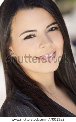 Outdoor portrait of a beautiful young Latina Hispanic woman or businesswoman smiling