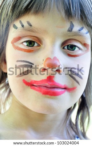 outdoor portrait of a child with his painted face