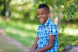 Outdoor portrait of a cute teenage black boy - African people