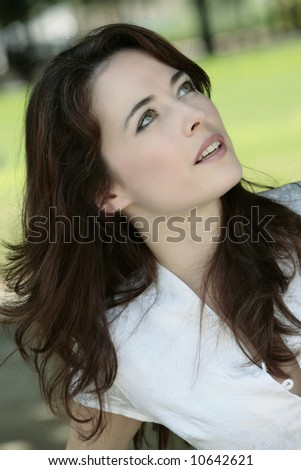 outdoor portrait of a expressive caucasian beautiful charming woman - stock photo