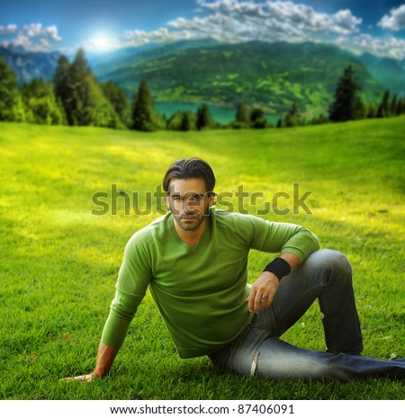 Outdoor portrait of a good looking man in scenic natural setting