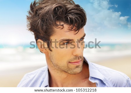 Outdoor portrait of a good looking young man
