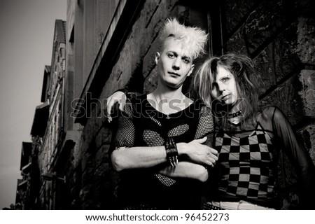 outdoor portrait of a goth punk couple