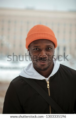 f56d8123444 Outdoor Portrait of a handsome brutal bearded man with dark beard and  mustache dressed in winter
