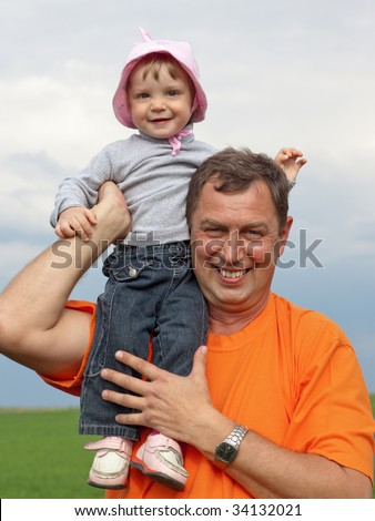 Outdoor portrait of a little girl with her grandfather