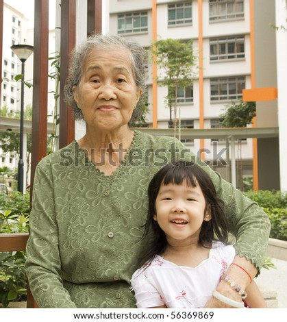 outdoor portrait of a senior woman with her granddaughter