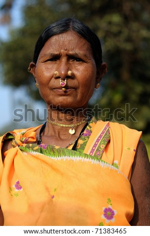 Outdoor portrait of a tribal India woman wearing ethnic jewelery and clothes
