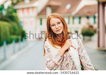 Outdoor portrait of adorable 10-12 year old girl wearing backpack Stockfoto ©