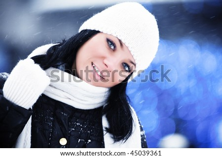 Outdoor portrait of beautiful smiling young woman