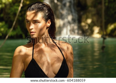 Outdoor portrait of  beautiful woman in jungles