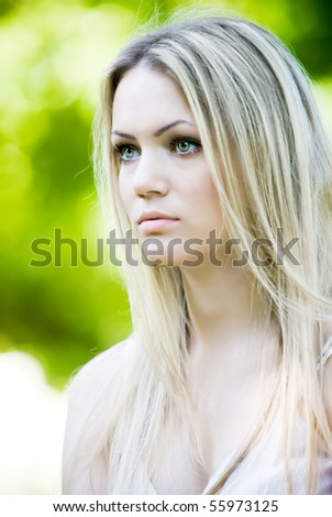 Outdoor portrait of beautiful young girl with long white hair