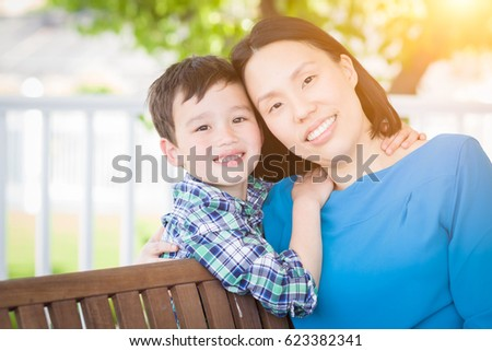 Outdoor Portrait of Chinese Mother with Her Mixed Race Chinese and Caucasian Young Boy #623382341
