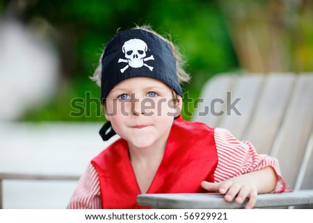 Outdoor portrait of cute boy dressed as pirate