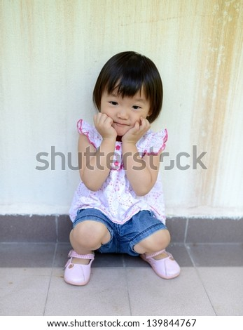 Outdoor portrait of cute little girl in summer day