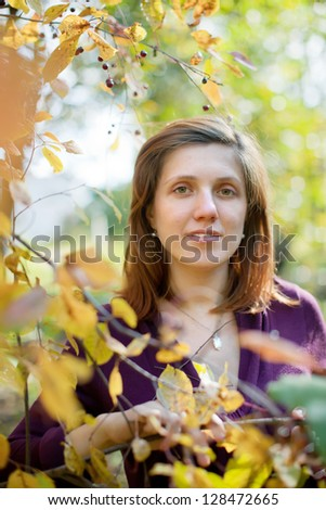 Outdoor portrait of girl at autumn park