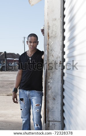 Outdoor portrait of handsome stylish African American man