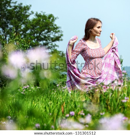 Outdoor portrait of happy woman