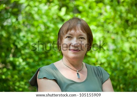 Outdoor portrait of mature woman